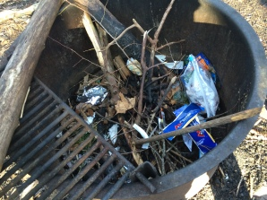 Ignorant people leave their trash in fire pits.  It doesn't burn completely.