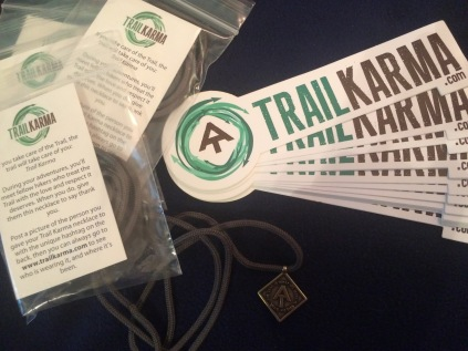 Trail Karma awards and promotional stickers.