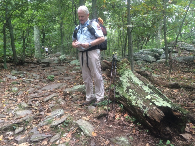 Hal Evans takes notes on trail conditions during his patrol.