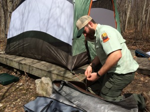 Preparing to string up the tarp.